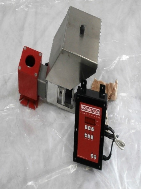 Volumetric doser with control cabinet